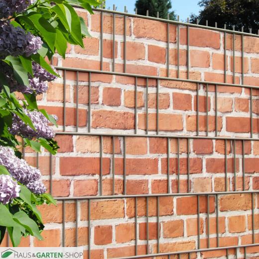 Zaunanlage mit Sichtschutzstreifen Backstein Mauer