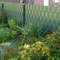 Moosgrüne M-tec Profi-line ® Sichtschutzstreifen im Zaun